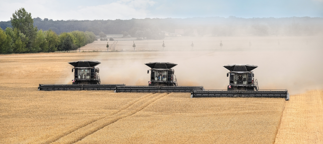 Three Fendt IDEAL combines threshing in the field.