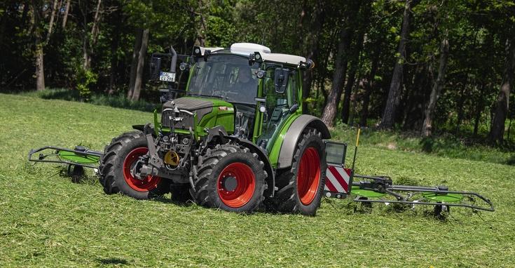 Fendt 211 Vario in grassland work with Fendt windrower attachment