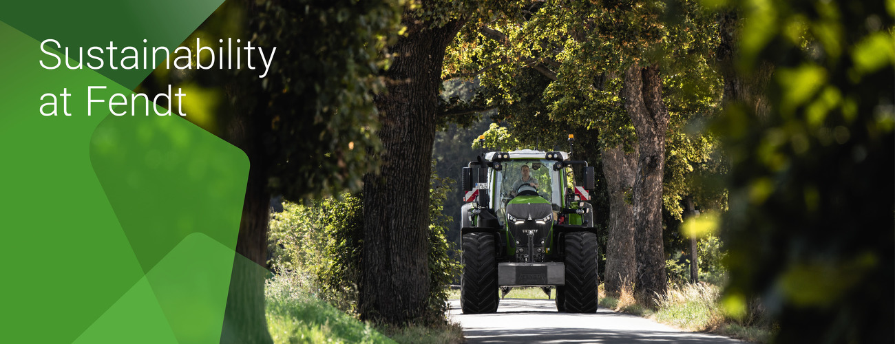 """Fendt 900 Vario drives through a beautiful avenue. On the left is the text """"Sustainability at Fendt""""."""